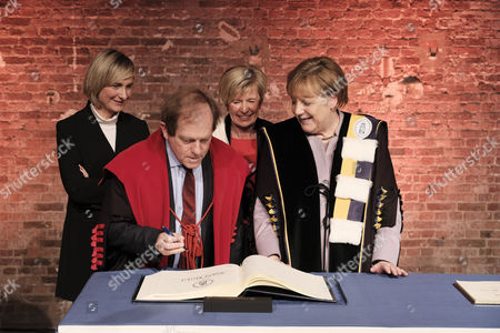Stock Photo of Rik Torfs, Hilde Crevits, Angela Merkel and Anne De Paepe - Presentation of a joint honorary doctorate from KU Leuven and UGent to German Chancellor Angela Merkel for her diplomatic and political efforts, Brussels