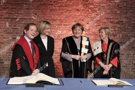 Rik Torfs, Hilde Crevits, Angela Merkel and Anne De Paepe - Presentation of a joint honorary doctorate from KU Leuven and UGent to German Chancellor Angela Merkel for her diplomatic and political efforts, Brussels