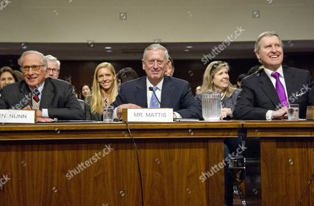 Former United States Senator Sam Nunn (Democrat of Georgia), left, and former US Secretary of Defense William Cohen, right, appear before the United States Senate Committee on Armed Services as it holds a confirmation hearing on the nomination of US Marine Corps General James N. Mattis (retired), center, to be Secretary of Defense on Capitol Hill in Washington, DC. Nunn and Cohen each introduced and endorsed Mattis for the post.