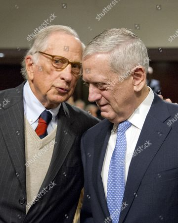 Former United States Senator Sam Nunn (Democrat of Georgia), left, and US Marine Corps General James N. Mattis (retired), right, share a thought prior to the US Senate Committee on Armed Services confirmation hearing on Mattis' nomination to be US Secretary of Defense on Capitol Hill in Washington, DC. Dunn, who served as Chairman of the US Senate Armed Services Committee from 1987 until 1995, introduced and endorsed Mattis.
