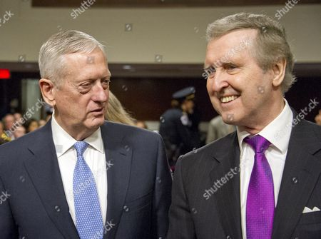 US Marine Corps General James N. Mattis (retired), left and former US Secretary of Defense William Cohen, right, share a thought prior to the US Senate Committee on Armed Services confirmation hearing on Mattis' nomination to be US Secretary of Defense on Capitol Hill in Washington, DC. Cohen, who also served in the US Senate as a Republican from Maine, introduced and endorsed Mattis.
