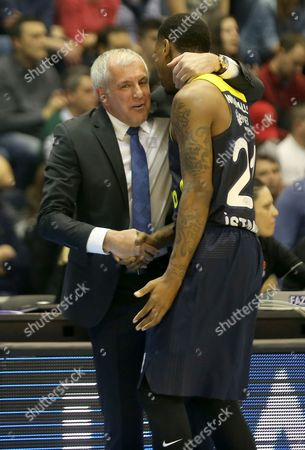 Zeljko Obradovic (L) head coach of Fenerbahce Istanbul talk with James Nunnally (R) during the Euroleague basketball match between Red Star and Fenerbahce Istanbul in Belgrade, Serbia, 12 January 2017.