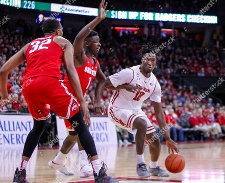 Nigel Hayes, Trevor Thompson, Jae'Sean Tate Wisconsin's Nigel Hayes (10) drives on Ohio State's Trevor Thompson (32) and Jae'Sean Tate (1) during the second half of an NCAA college basketball game, in Madison, Wis. Wisconsin won 89-66