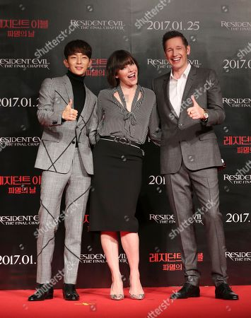 """Mira Jovovich, Lee Joon Gi, Paul W.S. AndersonWLD Actress Milla Jovovich, center, South Korean actor Lee Joon Gi, left, and director Paul W.S. Anderson pose for the media before a press conference for their new movie """"Resident Evil: The Final Chapter"""" in Seoul, South Korea,. The movie is to be released in South Korea on Jan. 25"""