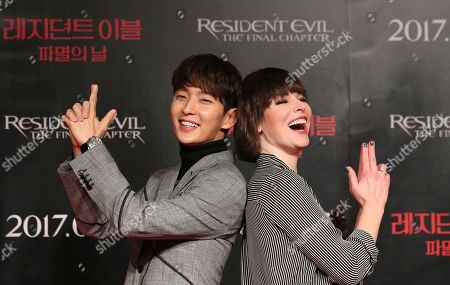 """Actress Milla Jovovich and actor Lee Joon Gi pose for the media before a press conference for their movie """"Resident Evil: The Final Chapter,"""" in Seoul, South Korea,. The movie is to be released in South Korea on Jan. 25"""