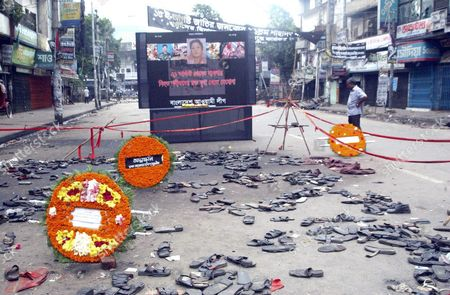 Bangladeshis Placed Flower Wreaths On the Site of the August 21 Attack On an Opposition Rally at Bangabandhu Avenue in Dhaka Monday 30 August 2004 Bangladesh Was Brought to a Standstill Monday by the Fourth General Strike in a Week Called by the Opposition Which Has Stepped Up Its Campaign to Oust the Government Since an Assassination Attempt On Its Leader the Shutdown Was Called by the Awami League's Women's Wing to Protest Against the Assassination Attempt On Party Leader Sheikh Hasina Wajed Which Killed 20 Other People Including the Wing's Leader Ivy Rahman