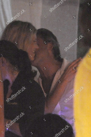 Stock Picture of Kate Moss getting cosy with Italian playboy Tommaso Buti