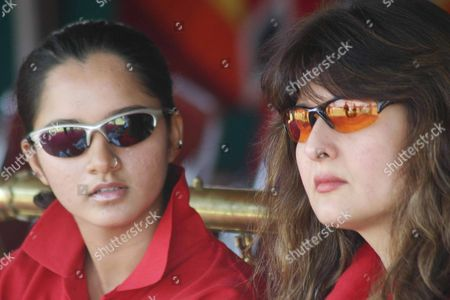 Former Bollywood Actress Sangeeta Bijlani (r) and India's Tennis Star Sania Mirza (l) Sit As They Watch a Friendly Cricket Match in Hyderabad India Tuesday 14 December 2004
