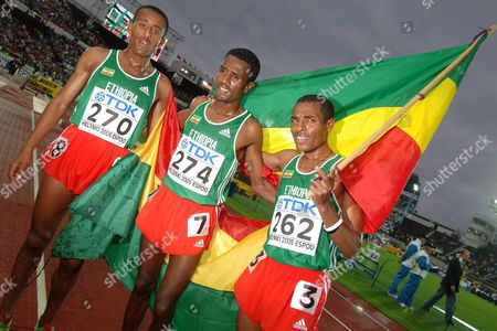 Ethopian Runners (from Left) Abebe Dinkesa Negera Sileshi Sihine and Kenenisa Bekele Pose with Their Country's Flag After the Men's 10 000m Final at the 10th Iaaf World Championships in Athletics Helsinki Finland Monday 08 August 2005 Ethopian Kenenisa Bekele Won Ahead of Compatriot Sileshi Sihine and Moses Mosop of Kenya Dinkesa Negera Placed 7th