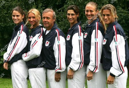The French Women's Tennis Team Members Pose For Photographers On the Eve of the Final of the Fed Cup Against Russia at Roland Garros Stadium Paris 16 September 2005 Left to Right: Nathalie Dechy Tatiana Golovin Captain Georges Goven Virginie Razzano Mary Pierce and Amelie Mauresmo