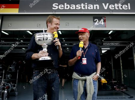 Stock Image of German Tv Presenter Florian Koenig (l) and Former Formula 1 World Champion Niki Lauda (r) of Austria Are Seen Outside the Garage of Germany's Sebastian Vettel Before the Third Practice Session at the Bahrain International Circuit Sakhir Bahrain 25 April 2009 German Formula One Driver Timo Glock of Toyota Finished First in the Session Followed by Brazilian Formula One Driver Felipe Massa of Ferrari in Second Place and German Formula One Driver Nico Rosberg of Williams F1 in Third the Formula One Grand Prix of Bahrain Will Take Place On Sunday 26 April 2009 Foto: Diego Azubel