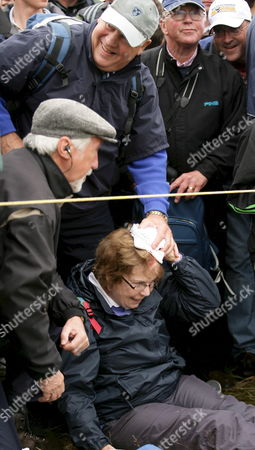 Ms Jennifer Wilson (63) From Armagh Holds Her Head After Being Hit by a Wayward Shot by Us Golfer Tiger Woods On the 6th Hole On the Third Day of the British Open Golf Championship at Carnoustie Scotland 21 July 2007