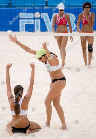 Brazil's Angela Vieira (2-l) and Vivian Cunha (l) Celebrate After Defeating China's Zhang Wen Wen (2-r) and Yue Yuan (r) in the Final Match of the Fivb Beach Volleyball Women's Challenge in Chaoyang Park Beach Volleyball Ground Stadium in Beijing China 19 August 2007 the Tournament is Part of a Series of Olympics Test Events Being Held in Beijing As the City Prepares For the Games in 2008 Brazil Won 2-0