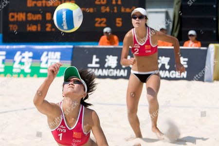 China's Sun Bing (l) Dives For a Ball As Her Team-mate Wei Zhao Chen (r) Looks On During Their Match Against Estonia On the Second Day of the Fivb Beach Volleyball Women's Challenge in Chaoyang Park Beach Volleyball Ground Stadium in Beijing China 14 Aug 2007 the Tournament is Part of a Series of Olympics Test Events Being Held in Beijing As the City Prepares For the Games in 2008 Estonia Defeated China 2-1
