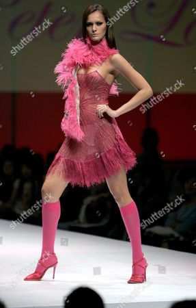 A Model Takes to the Cat Walk Wearing an Outfit by Hong Kong Fashion Designer Peter Lau at His Show On the Second Day of Hong Kong Fashion Week - Fall/winter 2008/09 Hong Kong China 15 January 2008 Hong Kong Fashion Week is Attracting 1 490 Exhibitors From 19 Different Countries