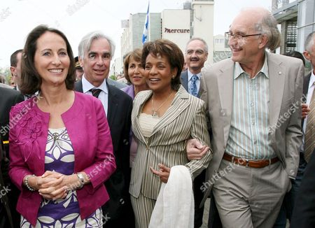 Stock Photo of Canada's Governor General Michaelle Jean Walks Before to Bid Farewell to the Crews of the Grande Traversee Flotilla Near Her Husband Jean-daniel Lafond (r) From La Rochelle to Quebec and (l to R) : Segolene Royal France's Socialist Leader (l) Maxime Bono Mayor of the Town Michaelle Jean and Her Husband the Governor is in the City After She Visited Ouistreham and Paris 08 May 2008