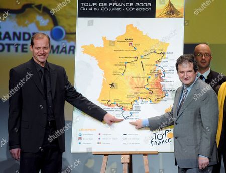 General Director of the Tour De France Cycling Race Christian Prudhomme (l) and Mayor of Barcelona Jordi Hereu (r) Point at a Map Showing the Route of the Tour De France 2009 After the Presentation in Paris France On 22 October 2008 the Race Will Start On 04 July 2009 in Monaco and End On 26 July in Paris