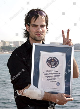 Escape Artist David Merlini Poses in Cannes France 14 October 2008 After Having Established a New Underwater World Record at the Mipcom Opening Cocktail at the Majestic Hotel in Cannes 13 October Merlini Held His Breathe For 20 Minutes and 39 Seconds Breaking the Previous Record of 17 Minutes and 19 Seconds His New Record Has Been Verified by the Guiness World of Records Mipcom 2008 is the Global Content Event For Creating Co-producing Buying Selling Financing and Distributing Entertainment Content Across All Platforms It Provides the Key Decision-makers in the Tv Film Digital and Audiovisual Content Production and Distribution Industry with the Only Market Conference and Networking Forum to Discover Future Trends and Trade Content Rights On a Global Level the Event Takes Place From October 13 to 17 2008