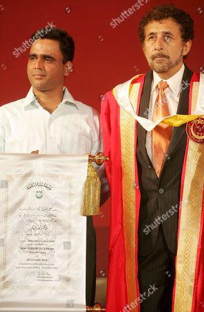 Indian Actor Naseeruddin Shah (r) Received an Honorary Degree of Doctors of Letters From the Vice Chancellor of Jamia Milia Islamia University Prof Mushirul Hassan (unseen) During Its Annual Convocation at Jamia Milia Islamia University Jamia Nagar New Delhi India On 30th October 2008 Naseeruddin Shah is a Leading Mainstream Bollywood Actor of the Indian Cinema and He Has Also Starred in International Projects