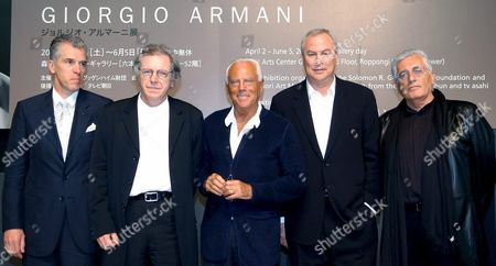 Italian Fashion Designer Giorgio Armani (c) Poses For Photographers with (l to R) Harald Hudak Director of Daimler Chrysler Japan David Elliott Director of Mori Art Museum Robert Wilson Exhibition Designer and Germano Celant Senior Curator of Guggenheim Museum During a Press Conference Held For an Exhibition of His Works at Tokyo's Mori Museum Thursday 31 March 2005 Armani's Exhibition Displays More Than 400 Garments Original Sketches and Audio-visual Presentations of His 30-year Career It Will Open From 2 April Through 9 June 2005