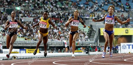 From Left - Carmelita Jeter of Usa Jamaican Veronica Campbell Torri Edwards of the Usa and French Christine Arron Cross the Finish Line in the Women 100m Race at the 11th Iaaf World Championships in Athletics Osaka Japan 27 August 2007