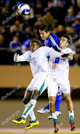 Saudi Arabia's Midfielder Abdulmalek Abdullah Al Khaibri (l) and His Teammate (r) Fight For the Ball with Japanese Player (c) During Their Final Round Match of the 2008 Olympic Games Preliminary in Tokyo Japan 21 November 2007 the Match Ended with a 0-0 Draw