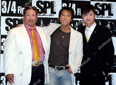 Actors Sammo Hung (l) Donnie Yen (c) and Wu Jing (r) Pose For Photographers During a Press Conference Held in a Tokyo Hotel to Promote the New Movie Titled 'Spl' Monday 23 January 2006 the Film Will Hit Japanese Screens On March 4th