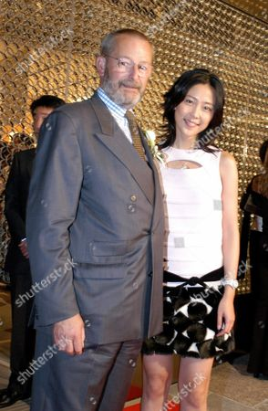 Patrick Louis Vuitton L Stands with Japanese Actress Yoshino Kimura at the Opening Party of the New Louis Vuitton Boutique in Roppongi Hills Tokyo Thursday 4 September 2003 Japanese Celebrities and Politians Joined the City's Fashion Elite to Check out the New Store the Store Opens to the Public Friday 5 September Epa Photo/epa/epa// Japan Tokyo