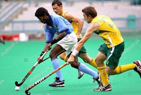 India's Ignace Tirkey (l) Beats Australian Michael Boyce (r) and Luke Doerner During Their Match at 14th Sultan Azlan Shah Cup Hockey Tournament in Bukit Jalil Hockey Stadium Near Kuala Lumpur Malaysia On Friday 03 June 2005
