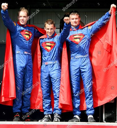 Red Bull Racing Team Drivers From L-r Dutch Robert Doombos Austrian Christian Klein and British David Coulthard Pose For Photos in Superman Costumes in Monaco in Monaco On Saturday 27 May 2006 the Monaco Grand Prix Will Take Place On 28 May Sunday