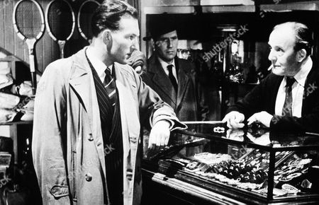 'Spaniards Curse'  Film - 1958 -  Mr Fredericks (Henry Oscar), the Pawnbroker, is questioned by a couple of plain clothes policemen in his shop.