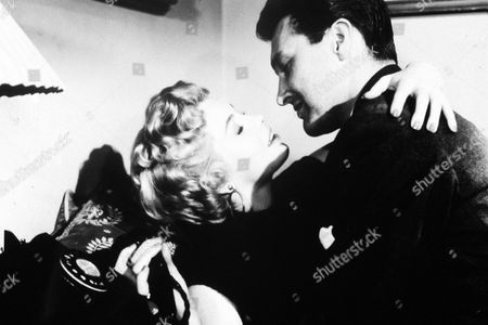 'They Can't Hang Me'  Film - 1955 -  Inspector Brown (Terence Morgan) shares an embrace with Jill Wilson (Yolande Donlan).