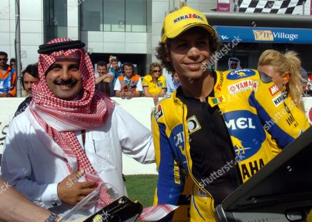 Italian Camel Yamaha Motorcyclist Valentino Rosi (r) Poses with Qatar Motor and Motorcycle Federation President Nasser Bin Khalifa Al Attiyah Before the Final Race of the Grand Prix of Qatar Held at at the Lusail International Circuit in Doha Qatar Saturday 08 April 2006