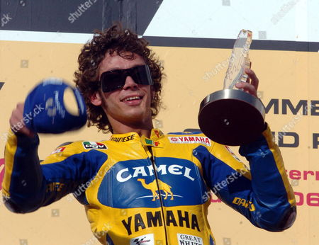 Italian Motorcyclist Valentino Rosi Celebrates His Victory After the Award Ceremony of the Grand Prix of Qatar Race Held at the Lusail International Circuit in Doha Qatar Saturday 08 April 2006