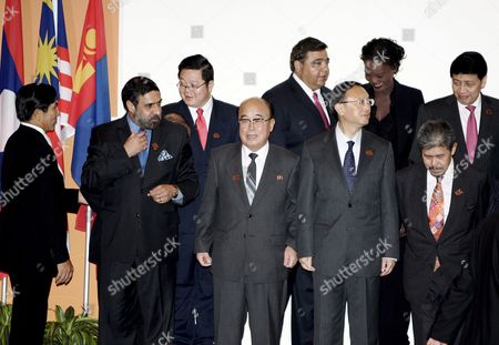 Stock Picture of Representatives and Asean Foreign Ministers Arrive For a Photo Session of the 15th Asean Regional Forum in Singapore 24 July 2008 (l-r) Front Row: Myanmar Foreign Minister Nyan Win Indian Deputy Foreign Minister Anand Sharma North Korean Foreign Minister Pak Ui Chun Chinese Foreign Minister Yang Jiechi Brunei's Foreign and Trade Minister Prince Mohamed Bolkiah Second Row: Cambodian Secretary of State Kao Kim Hourn Canadian Parliamentary Secretary to the Minister of Foreign Affairs Deepak Obhrai Eu Representative and French Minister of State For Foreign Affairs and Human Rights Rama Yade Indonesian Foreign Minister Hassan Wirajuda