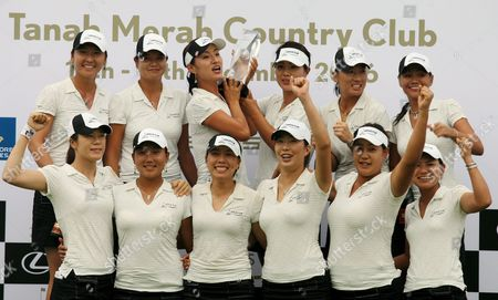(back L-r) Candie Kung Hee Won Han Grace Park Meena Lee Se Ri Pak Jennifer Rosales (front L-r) Young Kim Seon Hwa Lee Joo Mi Kim Shi Hyun Ahn Jee Young Lee Sakura Yokomine of Team Asia Celebrate After Winning the Lexus Cup Golf Tournament by One Point Against Team International Led by Sweden's Annika Sorenstam at the Tanah Merah Country Club in Singapore On Sunday 17 December 2006