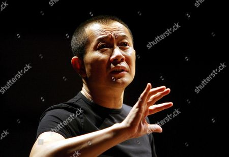 Chinese Composer Tan Dun Conducts the Singapore Festival Orchestra During a Rehearsal in Singapore 23 June 2008 Tan is in the City State For His Water Concert in Conjunction with the Singapore International Water Week Which Kicks Off 23 June 2008 and Will Bring Leaders and Experts From All Around the World to Discuss Management Policies the Impact of Global Warming and Diversification of Water Sources