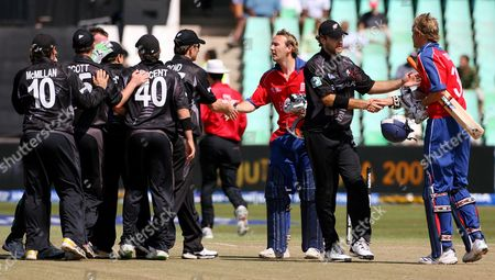 New Zealand Captain Daniel Vettori (2nd R) Shakes Hands with England Batsman Stuart Broad (r) While Team-mate Shane Bond (4th R) Shakes Hands with Chris Schofield (3rd R) As the New Zealand Team Celebrate Victory in the Icc Cricket World Twenty20 Championship Match Between England and New Zealand at Kingsmead in Durban South Africa 18 September 2007 New Zealand Won the Match by 5 Runs