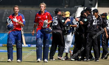 England Batsmen Chris Schofield (l) and Stuart Broad (2nd L) React As They Leave the Field While the New Zealand Team Celebrate Victory in the Icc Cricket World Twenty20 Championship Match Between England and New Zealand at Kingsmead in Durban South Africa 18 September 2007 New Zealand Won the Match by 5 Runs
