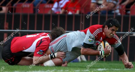 Crusaders Lock Isaac Ross (r) Dives Over the Line to Score a Try Despite a Tackle by Lions Captain Ernst Joubert (l) in the Rugby Super 14 Match Between the Lions of South Africa and the Crusaders of New Zealand Played at Coca Cola Park in Johannesburg South Africa 01 May 2009 the Crusaders Won the Match 32-20