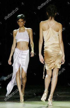 Super Model Omahyra Mota (l) Walks Down the Runway During the Luca Luca Show in Bryant Park During Mercedes Benz Fashion Week Seventh On Sixth's Spring Fashion Sunday 14 September 2003 in New York City Epa Photo/epa/jason Szenes// United States New York