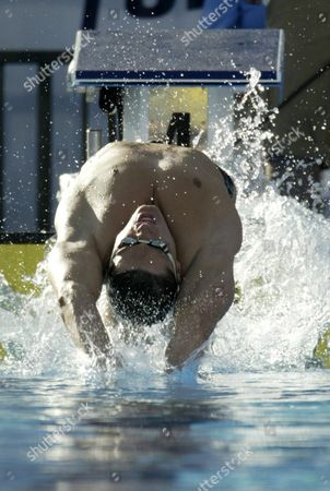 Swimmer Lenny Krayzelburg Jumps Back As He Start the Semifinal of the 100 Meter Backstroke During the U S Olympic Team Trials at the the Long Beach California Swim Center in Long Beach California Thursday 08 July 2004 Epa/armando Arorizo