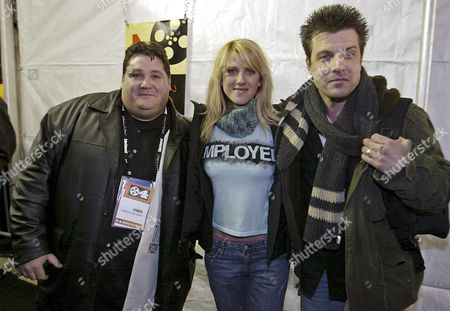 Stock Image of Writer Jay Laggett (l) Actress Andrea Bendewald (c) and Director Mitch Rouse Pose For the Photographers Before the Premiere of Their Movie 'Employee of the Month' at the 2004 Sundance Film Festival in Park City Utah Friday 16 January 2004