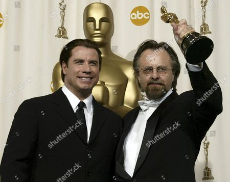 Us Actor John Travolta (l) and Polish Composer Jan a P Kaczmarek Pose with Kaczmare's Oscar Best Original Score For His Work On 'Finding Neverland' at the 77th Academy Awards in Hollywood Sunday 27 February 2005 Travolta Presented Kaczmarek with His Oscar