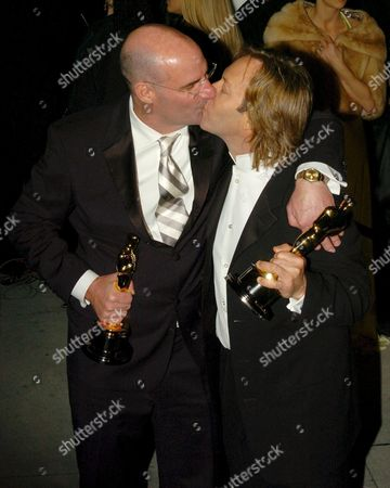 Stock Photo of Academy Award Winners Bobby Houston and Robert Hudson Kiss As They Arrive For the Vanity Fair Oscar Party in the West Hollywood Section of Los Angeles California After They Won Best Documentary Short For Their Movie 'Mighty Times: a Children's March' at the 77th Academy Awards Sunday 27 February 2005