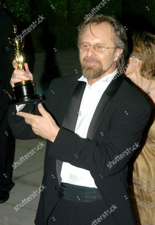Polish Composer Jan a P Kaczmarek Holds Up His Oscar As He Arrives For the Vanity Fair Oscar Party After the 77th Academy Awards in the West Hollywood Section of Los Angeles California Sunday 27 February 2005 Kaczmarek Won His Award For Best Original Score For His Work On 'Finding Neverland'