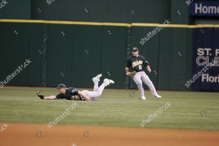 Oakland A's Right Fielder David Putnam (l) Makes a Diving Catch in Front of Teammate Chris Snelling (r) For the Third out During the First Inning of Their Game Against the Tampa Bay Devil Rays at Tropicana Field in St Petersburg Fl 06 May 2007 the A's Won the Game 5-3