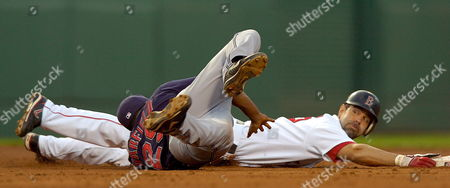 Boston Red Sox's Mike Lowell (r) Slides with Cleveland Indians Second Baseman Josh Barfield (l) During the Second Inning at Fenway Park in Boston Massachusetts 30 May 2007