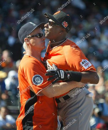 American Team Espn's Kenny Mayne (l) Congratulates Teammate Jerry Rice (r) During the Game For the Taco Bell All-star Legends and Celebrity Softball Game For the All-star Festivities at at & T Park in San Francisco California 08 July 2007