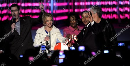 (l-r) Comedian Adam Carolla Singer Britney Spears Councilwoman Jan Perry and Los Angeles Mayor Antonio Villaraigosa with Usc Football Head Coach Pete Carroll Light the Tree On Stage at the 'Light of the Angels' Holiday Tree Lighting Ceremony at La Live in Los Angeles California Usa 04 December 2008